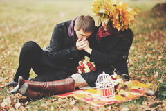 Young couple having date in autumn park. Royalty Free Stock Photography