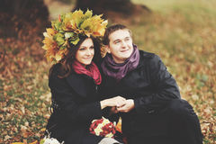 Young couple having date in autumn park. Royalty Free Stock Photo
