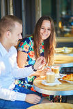 Young couple having a date in cafe, Paris, France Stock Photo