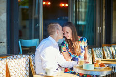 Young couple having a date in cafe, Paris, France Royalty Free Stock Photo