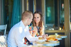 Young couple having a date in cafe, Paris, France Royalty Free Stock Photography