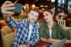 Young Couple Having Date in Coffeehouse Stock Photography