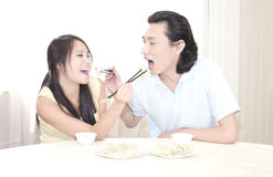 A young couple having dinner stock image