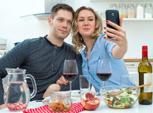 Young couple having dinner at home. Stock Photo