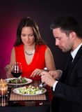 Young couple having dinner with wine Stock Images