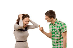 Young couple having a disagreement. As the women screams in anger and frustration at her boyfriend who is making a rude gesture with his finger, isolated on Stock Images
