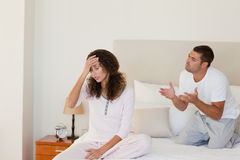 Young couple having a dispute on the bed Stock Image