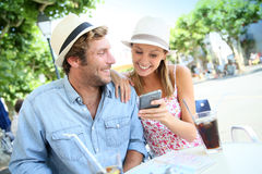 Young couple having a drink in town Royalty Free Stock Image