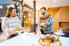Couple celebrating winter holidays indoors stock photography