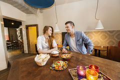 Young couple having food at restaurant Royalty Free Stock Photography