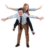 Young couple having fun. Image of a young couple having fun together against a white background Stock Photos
