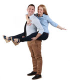 Young couple having fun. Image of a young couple having fun together against a white background Royalty Free Stock Image