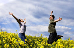 Young couple having fun. In summer rape field Royalty Free Stock Image
