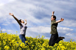 Young couple having fun. In summer rape field Royalty Free Stock Photos