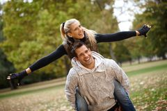 Young couple having fun in autumn park Stock Images