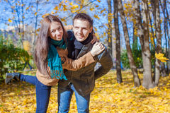 Young Couple having fun in autumn park on a sunny Stock Image