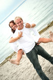 Young couple having fun on the beach Royalty Free Stock Photos