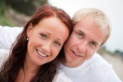 Young couple having fun on the beach Royalty Free Stock Photography