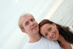 Young couple having fun by the beach Stock Photo