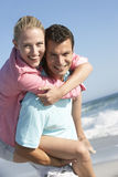 Young Couple Having Fun On Beach Stock Photography