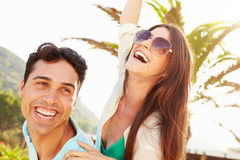 Young Couple Having Fun On Beach Holiday Together Royalty Free Stock Photos