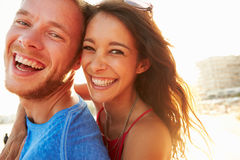 Young Couple Having Fun On Beach Holiday Together Royalty Free Stock Photo