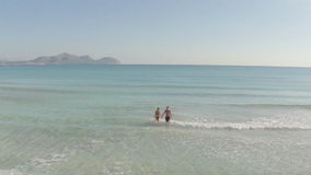 Young couple having fun at the beach. Majorca, spain stock footage