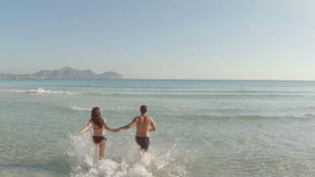 Young couple having fun at the beach stock video