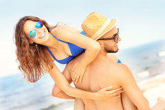 Young couple having fun at the beach Royalty Free Stock Images