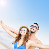 Young couple having fun at the beach Royalty Free Stock Photo