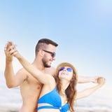 Young couple having fun at the beach Stock Photos