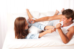 Young couple having fun in bed Stock Photo