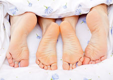 Couples feet Stock Images