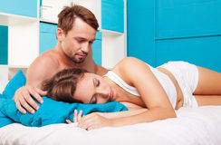Young couple having fun. In a bed Stock Image