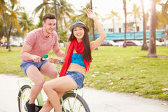 Young Couple Having Fun On Bicycle Ride Royalty Free Stock Photos