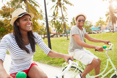 Young Couple Having Fun On Bicycle Ride Royalty Free Stock Images