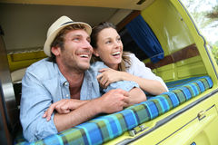 Young couple having fun in camping car Stock Image