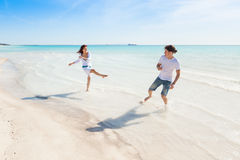 Young Couple Having Fun in a Caribbean Beach Stock Images