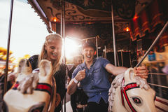 Young couple having fun on carousel Royalty Free Stock Photography