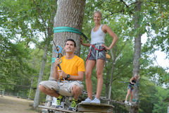 Young couple having fun climbing in trees. Young couple having fun climbing in the trees stock images