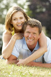 Young couple having fun in countryside Stock Image