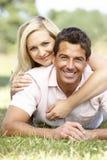 Young couple having fun in countryside Stock Photos