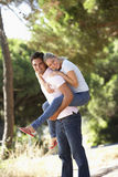 Young Couple Having Fun On Countryside Walk Royalty Free Stock Images