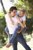 Young Couple Having Fun On Countryside Walk Stock Photography