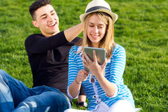Young couple having fun with digital tablet Stock Photos