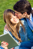 Young couple having fun with digital tablet Royalty Free Stock Photography
