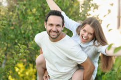 Young couple having fun in the garden by their house Royalty Free Stock Photo