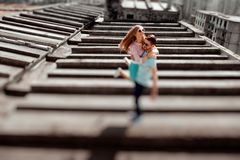 Young couple having fun on the gray roof of apartment building i Stock Image