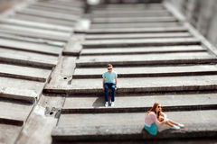 Young couple having fun on the gray roof of apartment building i Royalty Free Stock Image