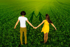 Young couple having fun on the green field in the spring or summ Stock Image